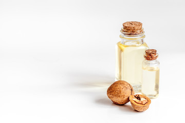 cosmetic and therapeutic walnut oil on white background