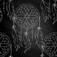 hand to draw a seamless pattern Dreamcatcher with beads and feathers of birds on the chalkboard