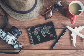 Traveler's accessories and items with black notebook and copy sp
