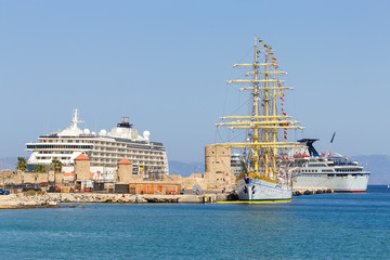 huge sailing ship on the background of two cruise liners at the port  Rhodes, Greece