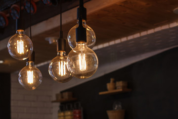 Decorative antique style filament LED light bulbs in restaurant.