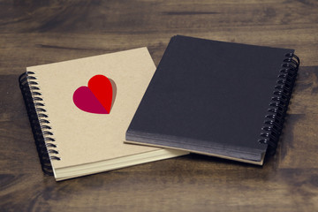 Red heart on abstract love with notebook on wooden background. Be my valentine. Love romantic messages with hearts.