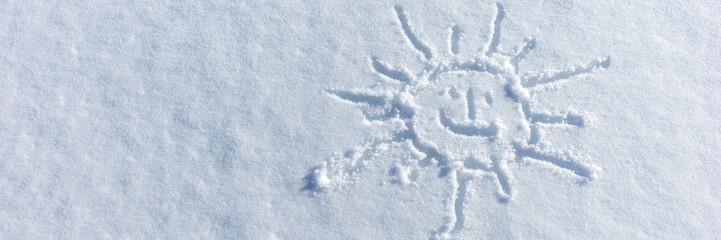 Sun drawn in the fresh white snow