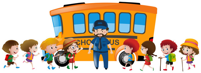 Children and bus driver standing by the schoolbus