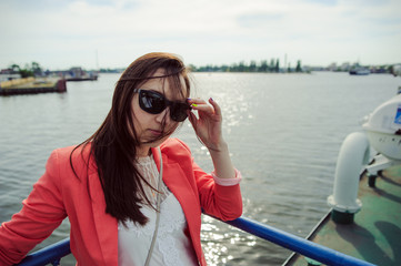 Young woman sailing on cruise liner or ferry with sea
