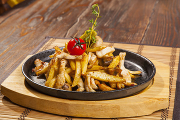 fried potatoes with mushrooms and chicken