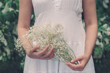 Girl holding flowers in their hands