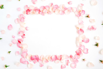 Frame made of pink roses petals on white background. Flat lay, top view. Valentine's background