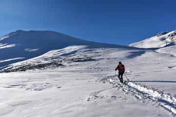 Hiker walking on mountain top Kasprowy Wierch. Tatra mountain