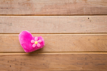 Pink heart on rustic wooden background, Valentine concept
