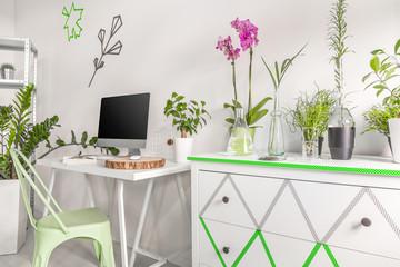 Minimalist computer desk in a bright room interior