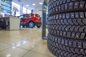 Winter tires in showroom of a car dealer