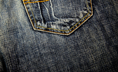 Pocket of a blue jeans.  Fabric background