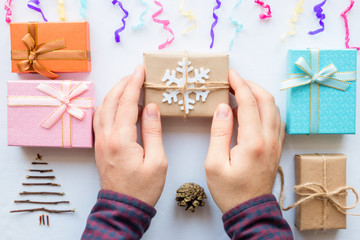 man making Christmas presents on a white background