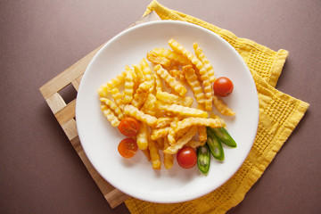 french fries on plate with tomatoes and chilli