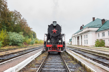 Rare steam train locomotive at the small railway station, Carpathians, Ukraine