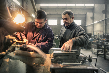 Workers helping each other in factory