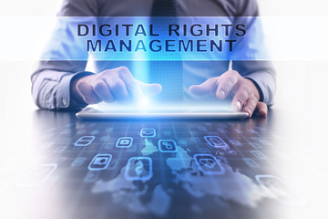 digital rights management concept. Businessman working with modern tablet pc.