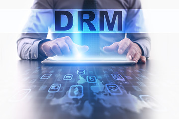 drm concept. Businessman working with modern tablet pc.