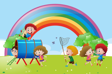 Spoed Foto op Canvas Regenboog Many children playing and dancing in the park