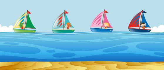 Four kids sailing at sea