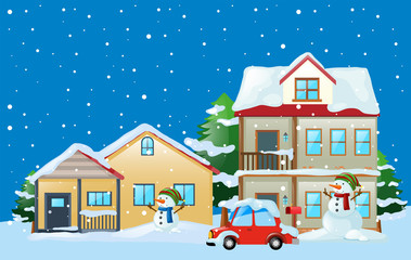 Scene with houses and snowman in winter