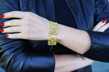 beautiful vintage gold Turkish Oriental handmade bracelets on the model's hand