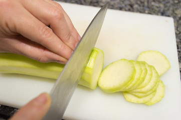 cutting slices of courgette