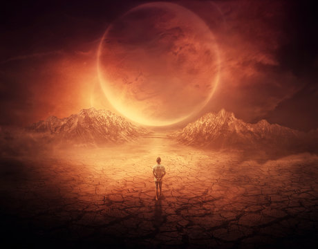 Surreal background as a young boy walks on another planet with dry and cracked ground, following a shining space object in the sky.