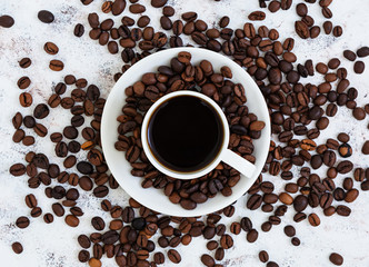 Coffee cup and coffee beans on white background. Top view. Flat lay