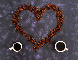 Coffee beans on dark background. Top view. Flat lay