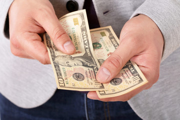 Close up of businessman hands counting dollar banknotes, isolate