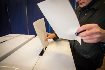 Person voting at polling station