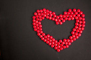 Red candy Heart shape over black gackground