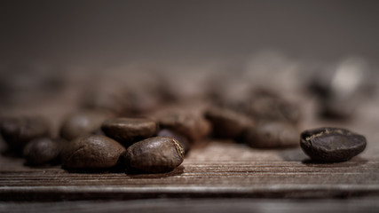 coffee beans closeup on brown wooden background