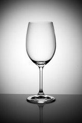 empty wine glass isolated on the light gray background