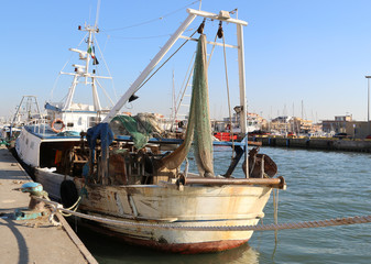 a Fishing ship in the harbor of Fiumicino, Rome, Italy