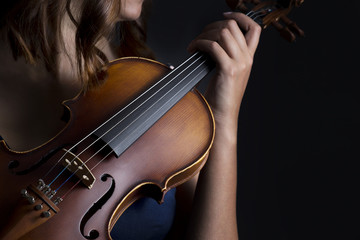 Violinist holding in your hands the violin.