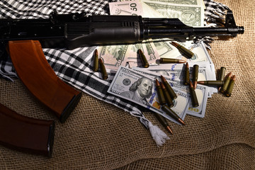Combat weapons, US dollars and ammunition scattered