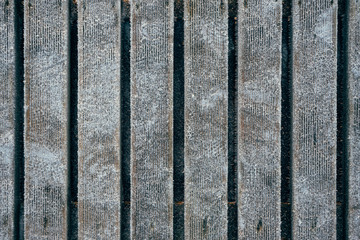 Wooden boardwalk covered with hoarfrost