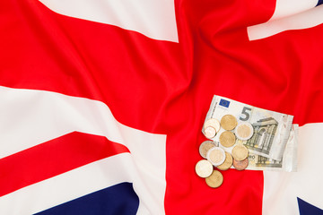Euro currency and coins lie on the background