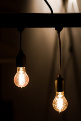 Bulbs hanging from a current thread in a dark room , creates a magical atmosphere