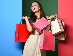 smiling colorful girl with bags