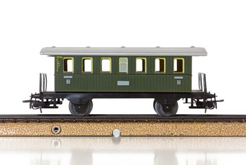 Model Train's Vintage Passenger Car on the Rails