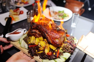 appetizing grilled meat on fire close-up. beautiful presentation of the dishes in the restaurant