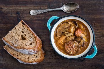 Traditional Sour Cabbage Soup with Sausage and Mushrooms