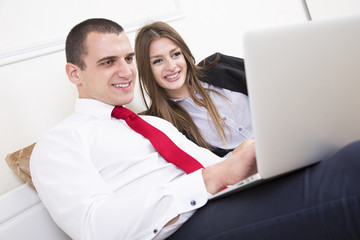 Close up of an couple in bed using a laptop.