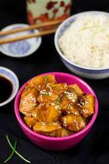 Chinese style sweet and sour chicken with sesame seeds