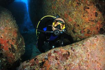 Scuba diver exploring underwater cave