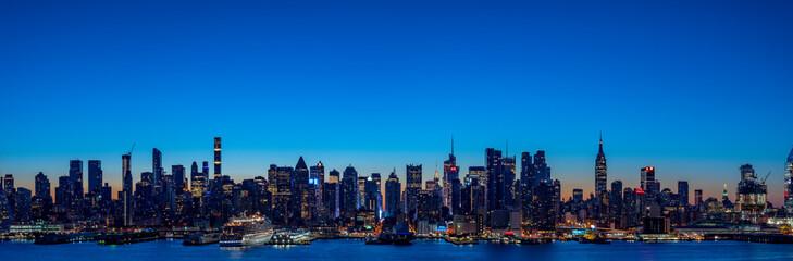 Super wide panorama of New York Manhattan skyline before sunrise